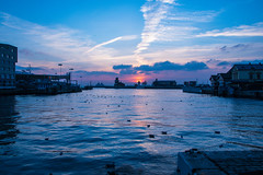 City sunset (Maria Eklind) Tags: streetsofhelsingborg sunset water birds city dusk lights sun helsingborg dock winter marina sweden sea ljus solnedgång boat drömljus hamntorget sky sunlight skånelän sverige se