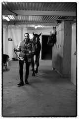 Walking / The Horse (Eline Lyng) Tags: bw monochrom monochrome blackandwhite inside horsestable farm horse animal people walking fuji fujixt2 xt2 fujinon xf fujinonxf16mm 16mm wideangle norway