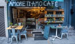2018 - Mexico City - Amore Ti Amo Café (Ted's photos - For Me & You) Tags: 2018 cdmx cityofmexico cropped mexico mexicocity nikon nikond750 nikonfx tedmcgrath tedsphotos tedsphotosmexico vignetting amoretiamocafe cafe coffeeshop streetscene street seating seats chairs tables emptyseats doorway rugs café