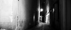 Dead Alley (elgunto) Tags: street people menacing silhouette atmosphere night nightlife alley beziers france blackwhite grain dxofilmpack trix400 sonya7 tamron287528 zoomlens laea4