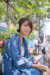 Happy young woman listening to music on Harajuku street (Apricot Cafe) Tags: img36608 asia asianandindianethnicities japan japaneseethnicity shibuyaward sigma35mmf14dghsmart tokyojapan beautifulwoman brownhair buildingexterior candid capitalcities carefree casualclothing charming cheerful citylife colorimage communication connection day enjoyment friendship greencolor happiness harajukudistrict headphones leisureactivity lifestyles listening lookingatcamera music nature oneperson onlyjapanese onlywomen onlyyoungwomen outdoors people photography portrait shopping shoppingbag sideview sitting smartphone smiling street student toothysmile women youngadult