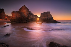 A Window To A New Day (Adam West Photography) Tags: adamwest algarve beach capturethemoment cliff cliffs composition contrejour dawn foam goldenhour hole longexposure movement portugal praia praiadoscareanos rock sea silhouette stack stone sun sunburst sunrise sunstar waves window