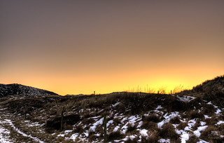 Sunset over the wintery dunes.