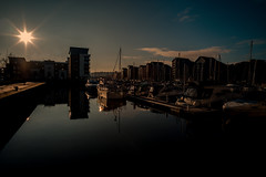Winter sun..... (Dafydd Penguin) Tags: winter sun water sunlight stars sunstars sea marina harbour harbor port dock yachts yachting boat sailboat sail moorings quay pontoon silhouette portishead west country uk bristol leica m10 elmarit m 21mm f28