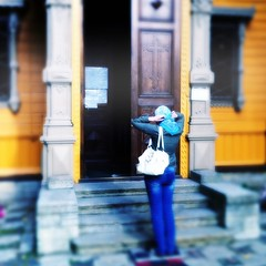 Reverence (solas53) Tags: russia orange church orthodox woman person focus blur blue door scarf pray