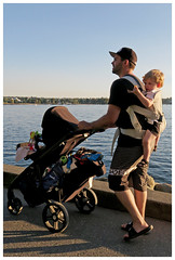 Walking the Seawall with Dad (HereInVancouver) Tags: fatherandson seawall candid ocean vancouverswestend thingstodobythewater water pacific englishbay canong16 stroller babypack vancouver bc canada