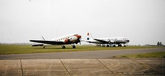 G-DAKK South Coast Airways Douglas DC-3 Dakota and PH-DDS Douglas DC-4 Skymaster parked at Duxford 02MAY99 (terence.stilgoe) Tags: douglas dc3 dc4 dakota skymaster dda phdds gdakk duxford iwm southcoastairways