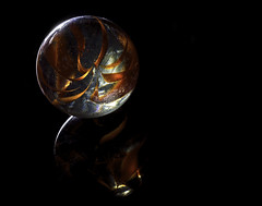 0246937588-96-A Child's Universe-1 (Jim There's things half in shadow and in light) Tags: america canon5dmarkiv macrophotography places tamronsp90mmf28dimacro11vcusd usa black closeup flash glass glow kid macro marble marbles reflection toy stilllife