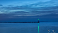 A green light in a blue world (BraCom (Bram)) Tags: 169 bracom bramvanbroekhoven goereeoverflakkee grevelingen holland le nederland netherlands ouddorp springersdiep baken beacon blauw blauweuurtje blue bluehour cloud groen lake langesluitertijd licht light longexposure meer morning ochtend pier reflection silhouet silhouette sky spiegeling star ster water widescreen wolk zuidholland nl