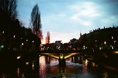 Sunset over a bridge. Strasbourg (Mimi & Oly) Tags: lights light neons neon neonlights lumière néon lightgarland lighttinsels laser minolta minoltasrt303b minoltasrt202 srt303b srt202 kodakportra400 kodak portra400 portra 50mm 50mmf14 street streetlights rue dehors streetphotography strasbourg alsace france strossburi christmas newyears newyear newyearseve 2018 nouvelan nouvelleannée noël est colombage halftimbering timbering timberpost christmaslights christmaslight xmaslights xmaslight xmas pont bridge water