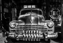 The Old Chevy (King Grecko) Tags: america bw gasoline ghosttown nelson nevada usa americana automobile barn blackandwhite car chrome contrast garge history lubrication mechanics motorvehicle oilcan old petrolpump signs vehicle vintage workshop