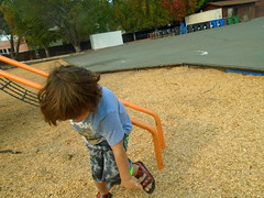 DSC01859 (classroomcamera) Tags: school campus playground mulch play playing boy jump jumping run running jungle gym monkey bars orange concrete blacktop lonely alone