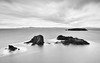 They Seem To Be Immovable (John Westrock) Tags: blackandwhite longexposure water clouds smooth rocky washingtonstate pacificnorthwest canoneos5dmarkiii canonef2470mmf28lusm bwnd1000x rosariobeach
