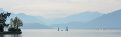 Lac d'Annecy (andyscho2004) Tags: annecy lacdannecy hautesavoie france europe panorama dualscreen lake yachts boats haze trees mountains alps alpine clouds nikon d7100 landscape avenuedalbigny sails sailboats blue layers mountainscape