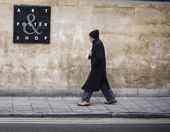 Art & Posters (Reckless Times) Tags: blackwells art poster shot oxford university oxforduniversity nikon walker man walking black cotswold stone wall stride d750