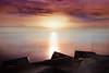 Last dawn on earth 2.0 (Lluvia Fotografia) Tags: canon dawn sunset reflection ndfilter longexposure rocks sky beach breakwater catch sunshine sunrise seascape landscape barcelona bogatell