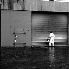 By painting the main entrance (pascalcolin1) Tags: paris13 homme man blanc white reflet reflection painting peinture pluie rain photoderue streetview urbanarte noiretblanc blackandwhite photopascalcolin 5omm canon50mm canon carré square