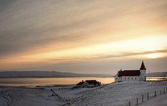 (Tom Roadcap) Tags: iceland west fjords snow frozen water bay mountain sun orange glow church desolate quiet serene empty