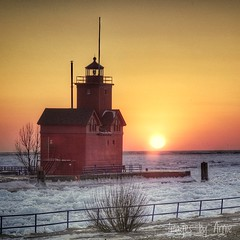 A Big Red Sunset too (Images by Arnie) Tags: lake westmichigan michigan winter ice lighthouse light bigred redsky orangesky sony