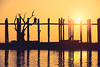 Silhouette of people traveling across the U Bein Bridge in the evening. Mandalay Myanmar (Patrick Foto ;)) Tags: amarapura ancient architecture asia asian attraction background beautiful bein bridge building burma colorful countryside culture evening famous footbridge golden lake landmark landscape life longest mandalay myanmar nature old orange peaceful people place reflection river rural scene silhouette sky structure sun sunrise sunset teak tourism travel u ubein walking water wood wooden mandalayregion myanmarburma mm