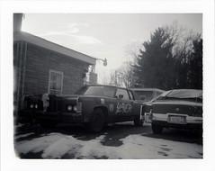 Fruitport, MI (moominsean) Tags: polaroid 190 instant type664 expired062009 michigan fruitport cars drsatan midwest snow