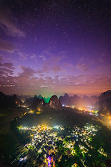 That night in Xingping (Luca Ferroglio) Tags: blessed night landscape sunset season stars photographystyle time evening town clouds photomerge sun adventure beautiful river hiking location mountain nightlights autumn heaven amazing water guangxizhuangautonomousregion karstpeaks hills longexposure liriver travelling peace travelphoto dryseason manmade guilin xingping yangshuocounty sky features china feelings stunning valley