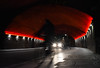 Week 6. Last Night's a Blur (hmcgee18) Tags: cyclist bike night lights headlights red bridge bricks texture movement streetphotography leadinglines motion nikon d3400 street photography