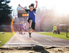 Seize the Day (Jenny Onsager) Tags: sports kids longjump sunflare sand track jumping effort carpediem