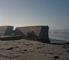 Cement beach (ADMurr) Tags: california pacific ocean water cement rip rap surf sand sky rolleiflex 35 e kodak portra caa855