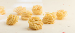 Noodles. (annick vanderschelden) Tags: yellow noodles staplefood unleaveneddough stretched extruded flat thin long cook boiling dried gluten wheat ingredients eggs pasta orientalcultural thailand china belgium