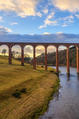Golden hour at Leaderfoot Viaduct (MilesGrayPhotography (AnimalsBeforeHumans)) Tags: 1635 fe1635mm sonyfe1635mmf4zaoss architecture a7ii melrose britain bridge viaduct drygrangeviaduct drygrange europe evening fe f4 glow golden goldenhour historic historicscotland iconic ilce7m2 landscape lens landscapephotography nd outdoors old oss photography photo portrait photographer tranquil reflections rocks river rivertweed scotland sky scenic skyline sunset sunlight sonya7ii sony sonyflickraward scottish scottishlandscapephotography scottishborders town trees uk unitedkingdom village waterscape water winter zeiss