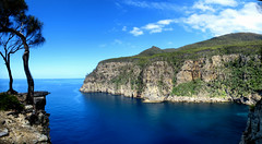 Waterfall Bay (im me) Tags: tasmania australia hiking mountains tree water bay ocean cliff cliffs blue sky clouds landscape panorama coast tasmanpeninsula waterfallbay bluff shore boat sea tasmansea pacificocean tasmannationalpark