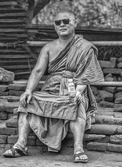 Cool Monk (Images by Bob Richards) Tags: buddhist rockfortress sigiriya srilanka monk unposed candid streetphotography monochrome blackandwhite sunglasses bottle water cool