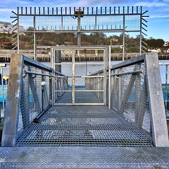 Entrance to the Pontoon (Julie (thanks for 9 million views)) Tags: waterford hff gate pontoon fence squareformat 2018onephotoeachday ireland irish metal water riversuir