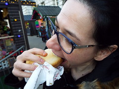 Saucy Sandwich... Nina at the Christmas Market in Belfast December 2017 (sean and nina) Tags: nina christmas market belfast city centre public candid street photography woman female girl lady girlfriend fiancee wife happy amiling marries black duffle coat dress legs dm boots doc martens beauty gorgeous stunning amazing cute charm charming serb north northern ireland irish eu europe european aire glasses brunette long dark hair camer people persons outdoor outside model perfect december 2017 eating drinking smiling walking incredible pose posed posing unposed