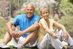 Senior Couple Resting Aftre Exercising In Park (antiagingninjas) Tags: 50s 60s active bottle bottleofwater caucasian copyspace countryside couple drinking embrace embracing enjoying exercise female fifties fit happy havingfun healthy healthycouple laughing lifestyle male man mature maturecouple older oldercouple olderman olderpeople outdoors park people person portrait resting senior seniorexercise seniorshavingfun sixties smiling together vertical water woman
