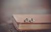 two hearts ... (Ayeshadows) Tags: earrings hearts dof booktop two greenstones metallic miniworld tinyminy
