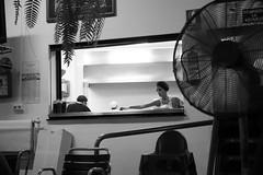 Framed (Five Second Rule) Tags: nerja spain coast blackandwhite woman chef restaurant staff window serving