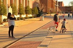 Recording the first training wheel free times (radargeek) Tags: ou norman oklahoma ok 2017 january shootingtheshooter red mom dad son dog bike bicycle child kid