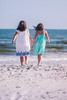 (Rebecca812) Tags: beach sistershood friendship love holdinghands hair breeze idyllic sundress girls sand water seashore ocean waves walking rearview canon people rebeccanelson rebecca812