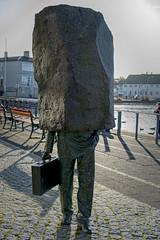 The Unknown Bureaucrat (emptyseas) Tags: artist magnús tómasson unknown bureaucrat raðhús city hall reykjavik iceland emptyseas nikon d800 early morning october 2017 tjörnin pond rock stone boulder case sculpture artwork