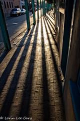 Santa Fe Shadows (lorinleecary) Tags: newmexico santafe shadows cars lines overhang walls