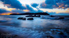 Rocks in the Tide (Deibertography) Tags: afternoon beach boulders clouds landscape nature ocean rocks sea shore sky sun sunsetting