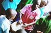 Boys drumming (thechelseagrin) Tags: africa uganda travel child praying boy