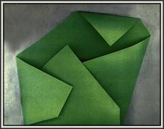 ^ > v (Bob R.L. Evans) Tags: green unusual irreverent foldedpaper design composition security warmth lightandshadow pattern geometric asymmetrical decor rhythm triangles