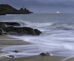 Sunrise Mumbles Style (MarkWaidson) Tags: mumbles sunrise le sea lighthouse cloudy beach shore morning swansea