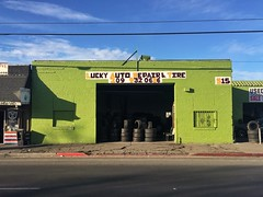 Lucky Rolls (misterbigidea) Tags: lucky afternoon bluesky signpainter business scenic city urban streetview building green lettering handpainted sign used repair auto tires tire wheels signsbymario