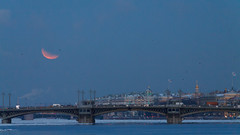 Lunar eclipse in St.-Petersburg (Suicidal_zombie) Tags: russia russie russland lunar eclipse moon red orange shadow astronomy hermitage saintpetersburg stpetersburg blagoveschenskiy bridge neva river water snow ice night evening blue hour sky skyscape cityscape waterscape