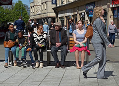 Trouser suit (Andy WXx2009) Tags: outdoors sitting bench man streetphotography bags girls shopping cardiff fashion style street wales europe candid people walking city crowd meeting women girl children urban blonde hat sunglasses brunette femme sexy minidress legs jeans trousersuit sidewalk