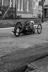 Wheelchair Athlete (burnt dirt) Tags: wheelchair bicycle bike athlete competition helmet uniform marathon halfmarathon 5k course race racer pedal wheel flag road street amputee prosthetic sunglasses glasses downtown town city bw blackandwhite fujifilm camera metro station busstation trainstation hero military xt1 streetphotography urban candid portrait documentary laugh smile winner medal sport vehicle outdoor people person abb5k houston texas houstonmarathon houstonhalfmarathon chevron man woman crank gloves sunny cold carbon